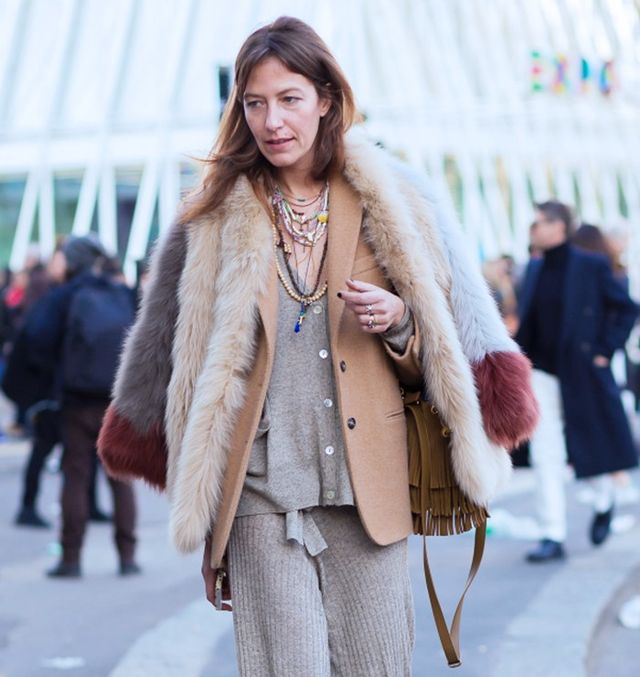 Style Notes: OK, technically this is a blazer and fur combo, butit totally prompts us to double a shoulder-robed furry number over a camel coat. She's in the clique!
