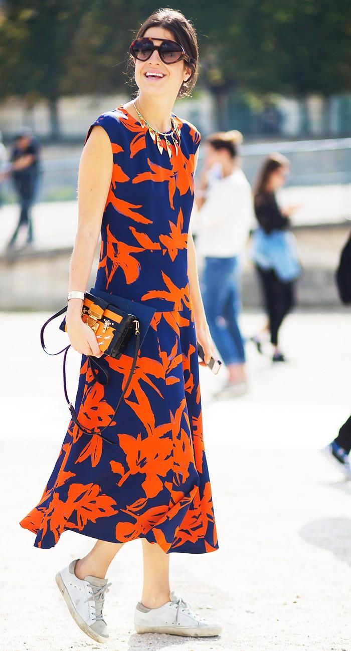 Leandra Medine wearing dress and sneakers