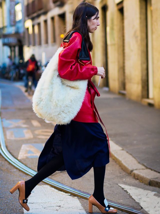 Style Notes: Red leather looks even better in a clash of textures—see the white shearling bag and heavy opaque tights with a woolen skirt?