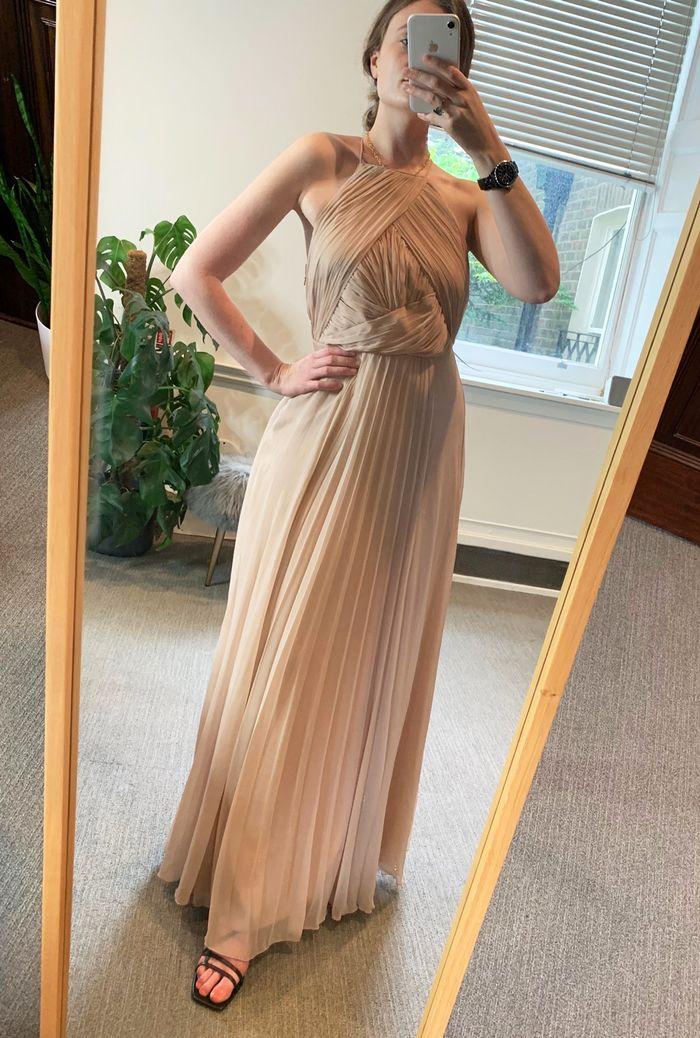 Matron of honor dress with bell sleeves and asymmetric hem This is a sage green v neck wedding dress with delicate waist tie and pleats.