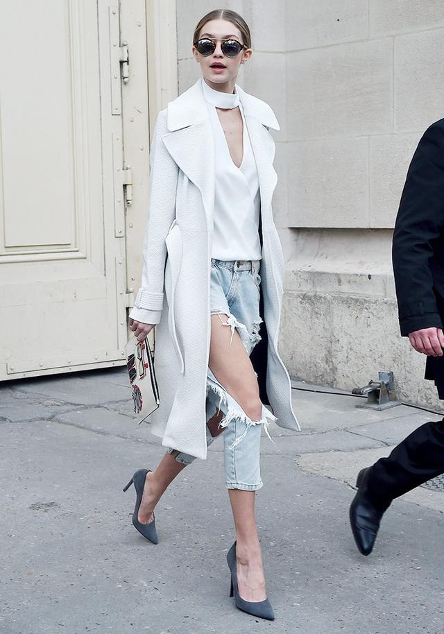 On Gigi Hadid:IllestevaMilan Tortoise Sunglasses(£275); ALC coat; One Teaspoon Awesome Baggies Ripped Boyfriend Jeans(£115); Karl Lagerfeld clutch; Saint...