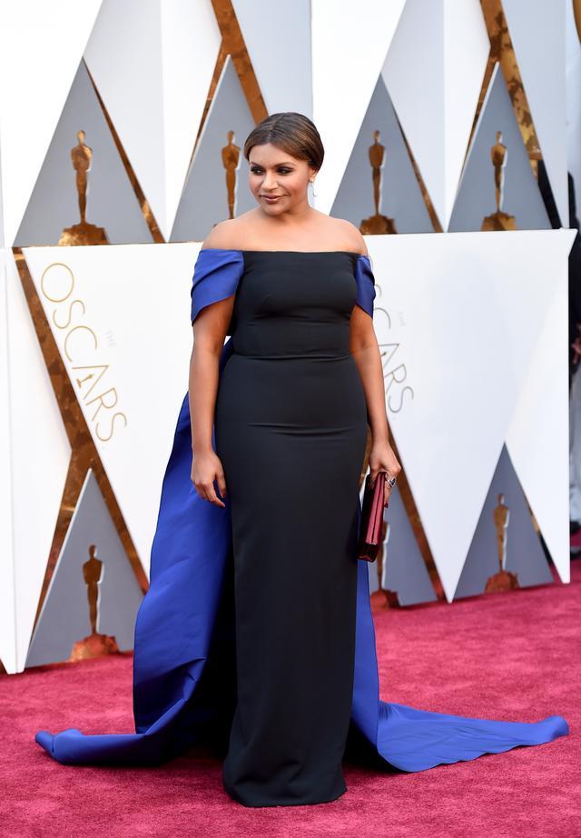 WHO: Mindy Kaling WHAT: Nominee, Best Animated Film for Inside Out WEAR: Elizabeth Kennedy dress; Effie jewelry; Prada clutch.