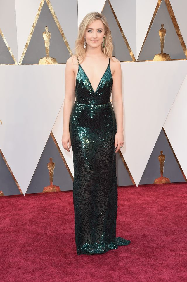 WHO:Saoirse Ronan WHAT: Nominee, Actress in a Leading Role for Brooklyn WEAR: Calvin Klein Collection emerald sequin dress with velvet straps; Chopard jewellery.