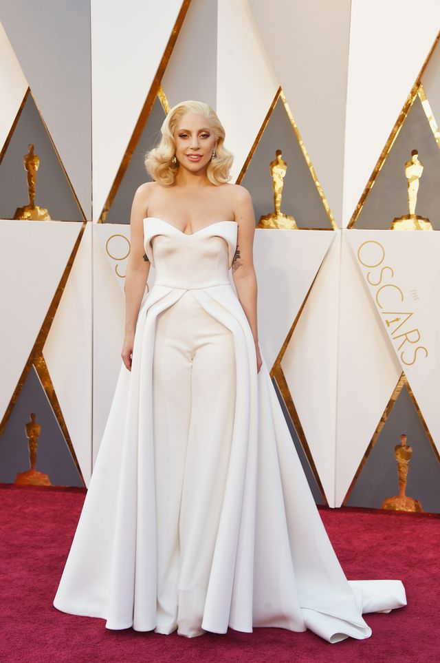 """WHO:Lady Gaga WHAT: Nominee, Music (Original Song) for """"Til It Happens To You,"""" The Hunting Ground WEAR: Brandon Maxwell jumpsuit;Lorraine Schwartz jewellery."""
