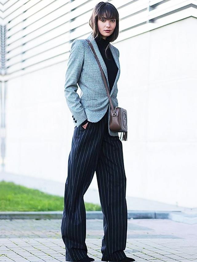 On Anne-Miek Kessels: Zara Buttoned Blazer(£50); Ralph Lauren trousers; Gucci Soho Leather Disco Bag(£650).