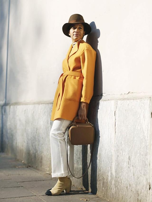 On Tamu Mcpherson:Marella Woolen Duster Coat(£420); Chanel boots.