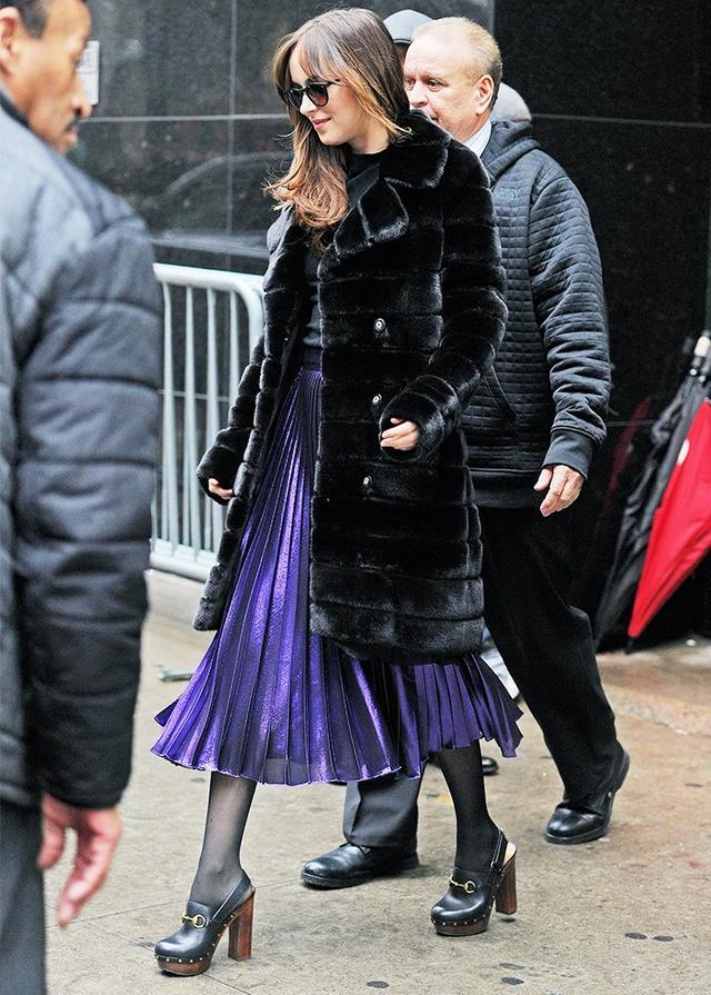 On Dakota Johnson: Gucci Lurex Plissé Skirt(£915) available in Gold; Gucci Amstel Platform Clog(£718). If you, like us, are feeling inspired by Dakota's...