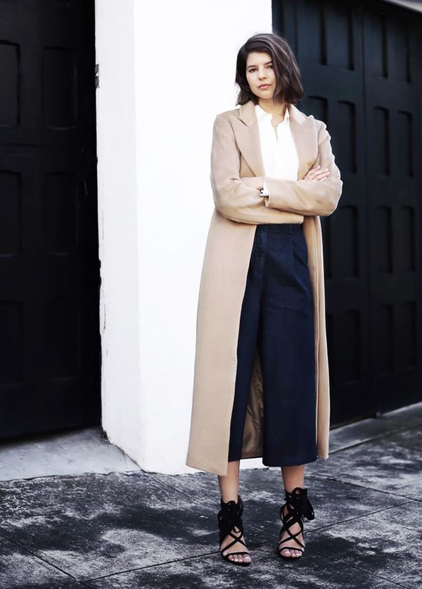 StyleNotes:For a timeless combination, style a tan trench with a crisp white shirt and cropped denim.