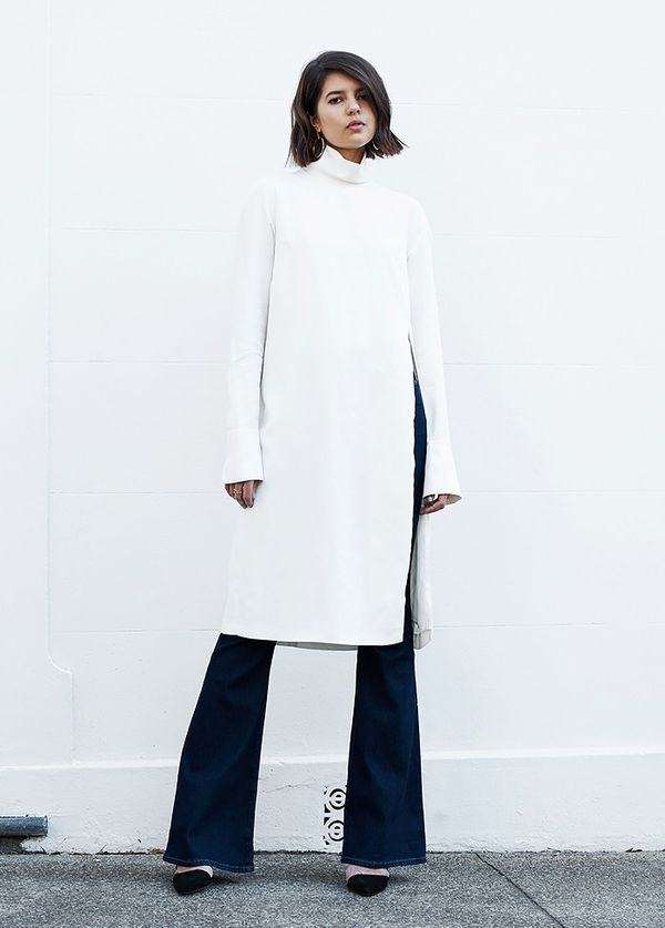 StyleNotes:Team a minimalist tunic with a pair of flared jeans.