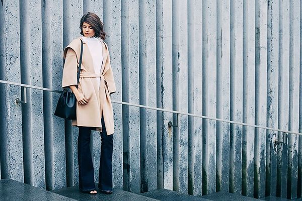StyleNotes:De-clunk your look with a belted coat and figure-flattering jeans.Keep going to shop pieces from her outfits.