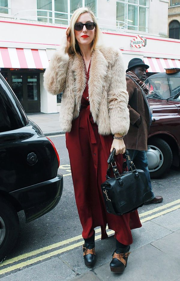 WHO: Joanna HillmanThe now fashion director at Harper's Bazaar layered a furry cropped coat over her crimson maxi.Keep going to shop standoutpieces inspired by street style!