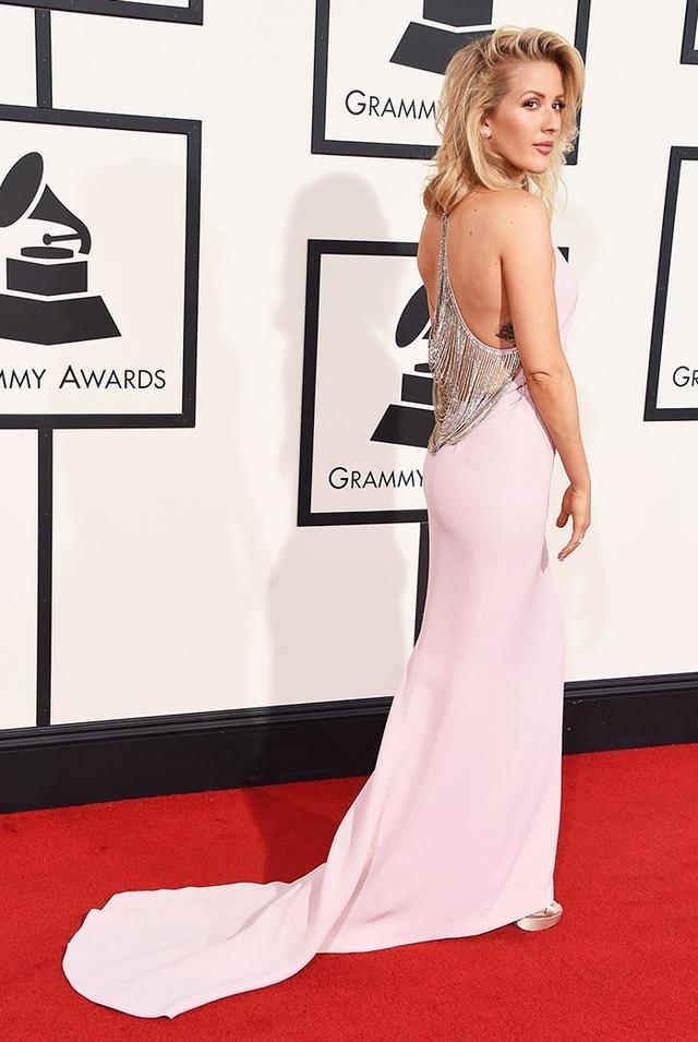 "WHO: Ellie Goulding WHAT: Nominee, Best Pop Solo Performance for ""Love Me Like You Do"" WEAR:Stella McCartney bespoke blush V-neck gown with diamond drape detail; Bulgari jewelleryand..."