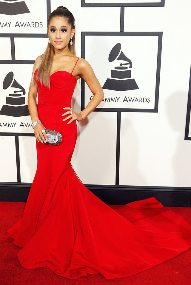 WHO: Ariana Grande WHAT: Presenter WEAR: Romona Keveza red silk crepe evening gown featuring a corset bodice and fluted skirt; Jimmy Choo clutch; Giuseppe Zanotti shoes.