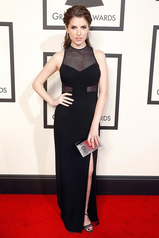 WHO: Anna Kendrick WHAT: Presenter WEAR: Emanuel Ungaro sleeveless black dress with slit and mesh detail; Harry Kotlar jewellery; Jimmy Choo sandals.