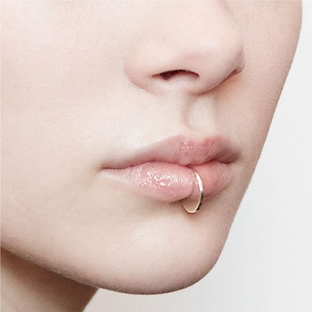 """It's Saturday the 13th and the models are backstage at Milk Studios. This is a detail photograph of the lip pieces we designed to complement Dion's concept of 'piercing'...."