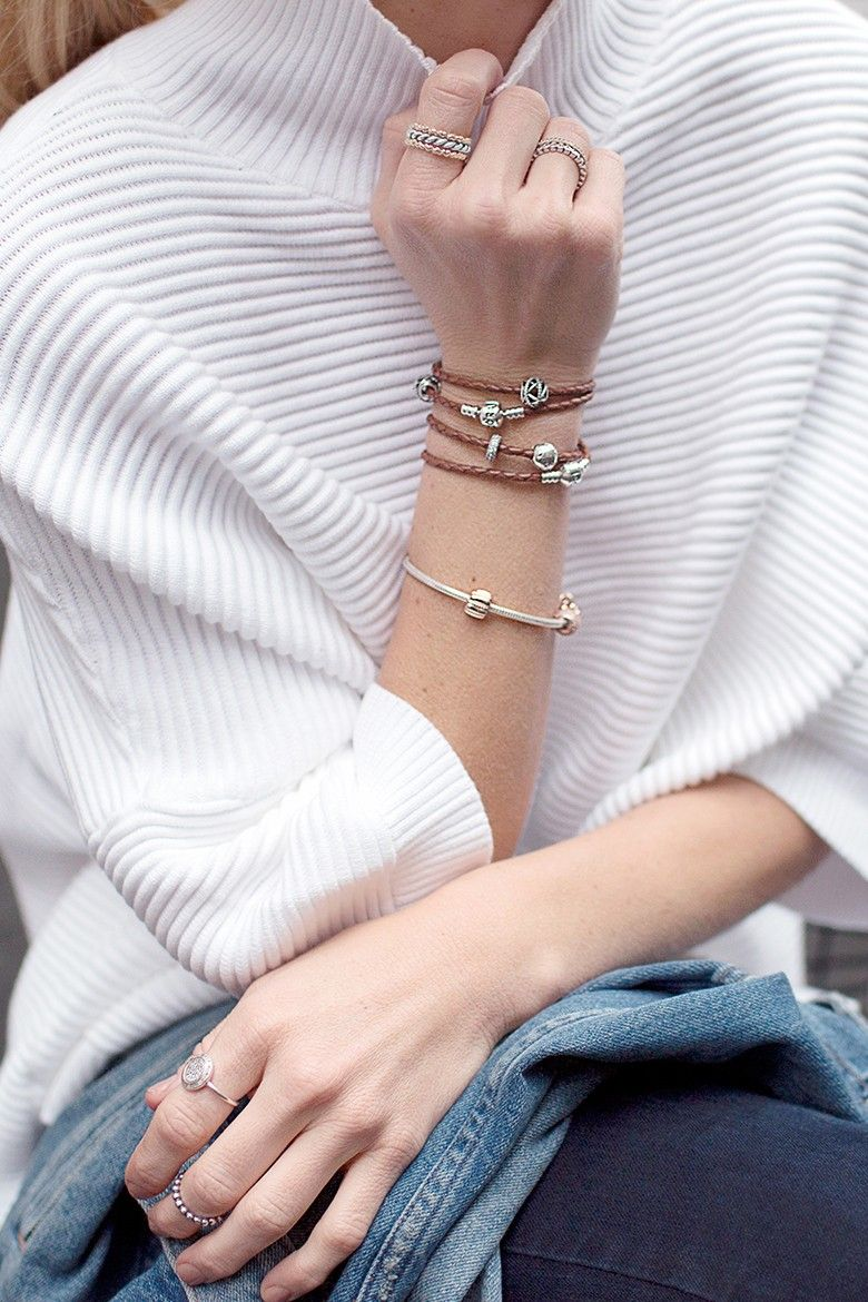 "<p>""For more of a daytime feel, I styled my silver Galaxy charm with wrapped Double Leather bracelets and stacked in silver and gold rings."" — Happily Grey</p>"