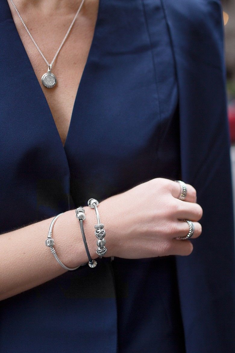 "<p>""To dial it up a bit in my navy cape dress, I incorporated stacking bracelets. It's so jazzy and the perfect complement to elevate an evening outfit."" — Happily Grey</p>"
