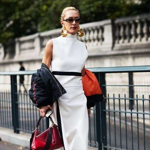 white shoes trend: Elina Halimi wears Louis Vuittons white ankle boots in Paris