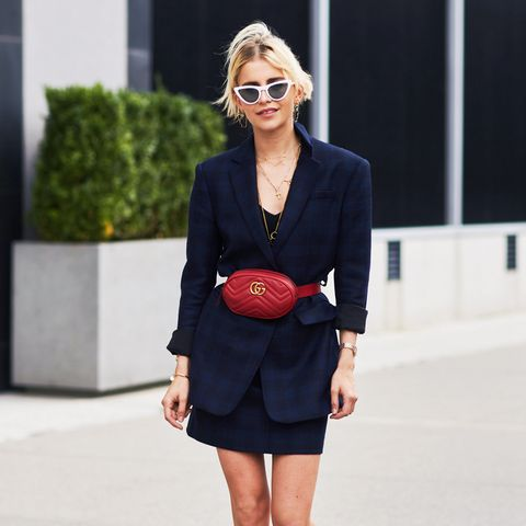 white shoes trend: Caro Daur wearing white shoes with red socks
