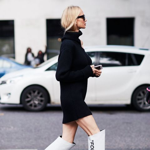 white shoes trend: Balenciaga's white knee-high boots on the streets of fashion week