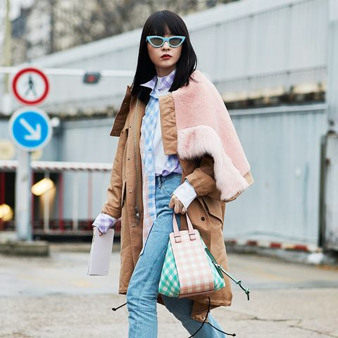 white shoes trend: street styler wearing pastels and white boots