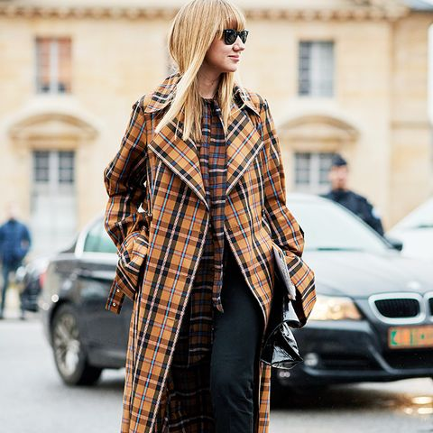 white shoes trend: lisa aiken wearing checks and white boots