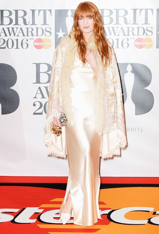On Florence Welch: Alexander McQueen clutch bag; Charlotte Olympia shoes.