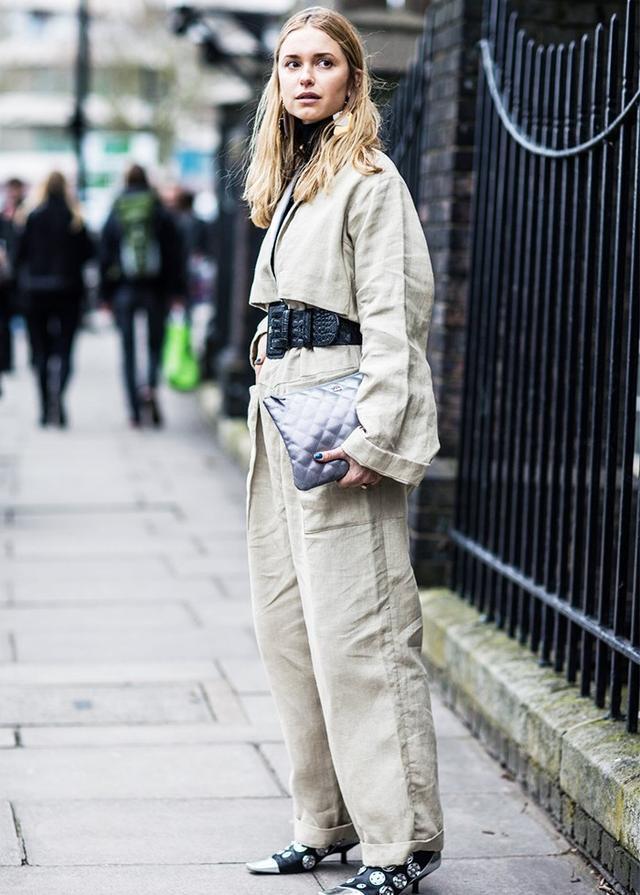 On Pernille Teisbaek: Loewejumpsuit; H&Mroll-neck; Ganni Waist Belt(£90); Chanelbag; Loeweboots.