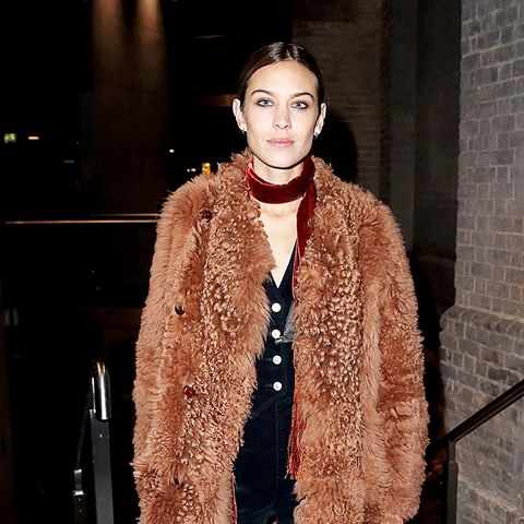 Alexa Chung Wears Textured Coat, Skinny Scarf, and Loafers