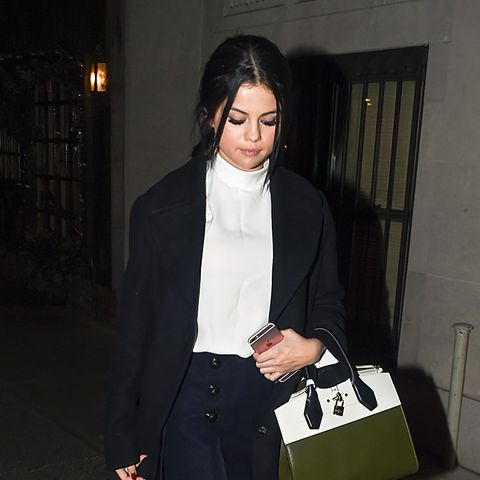 Selena Gomez Wears Turtleneck, Mini Skirt, and Ankle Boots