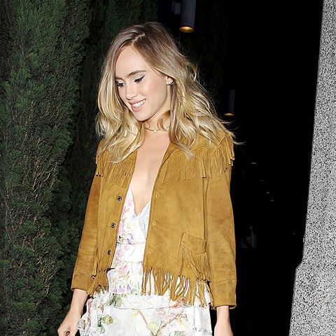 Suki Waterhouse Wears Suede Jacket, Flirty Dress, and Leather Sneakers