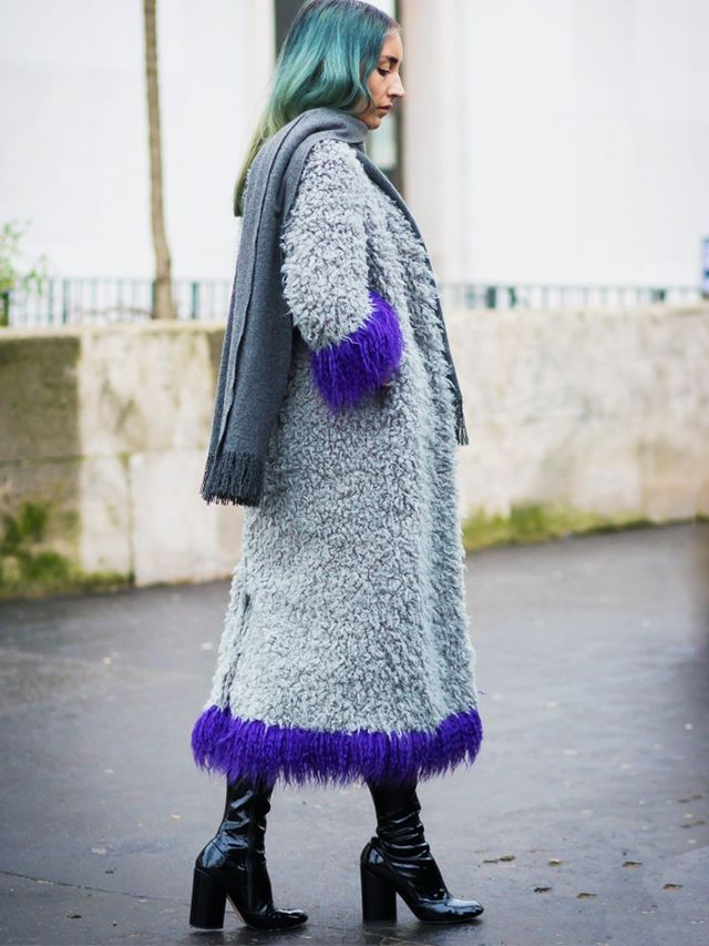 Style Notes: You don't need to accessorise heavily when a statement coat does the talking. Elizabeth Fraser-Bell just adds pull-on boots and a plain grey scarf.