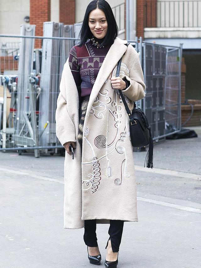 On Tiffany Hsu: Peter Pilottocoat; Altuzarra Ghianda Knot Saddle Bag (£3106) available in Python Leather.