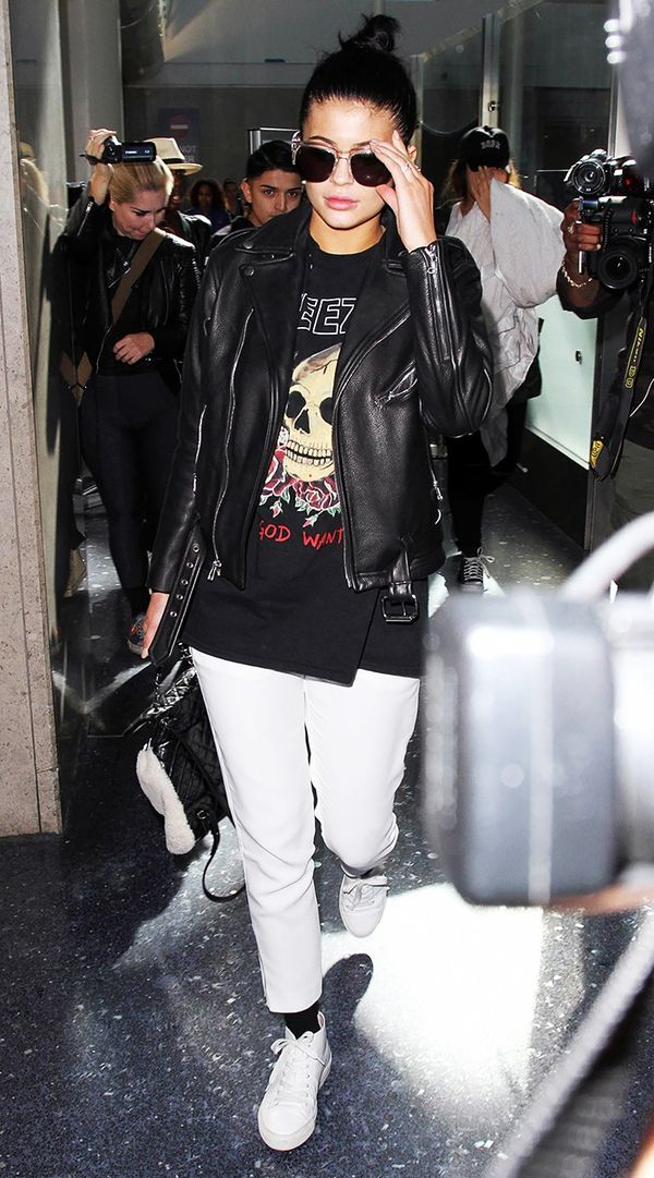 She manages to make any T-shirt look ultra cool by styling it with stark white jeans, sneakers, and a leather biker jacket.