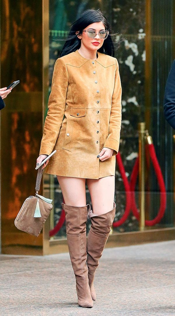 She embraces trending textures to the fullest as she daringly doubles up on the material—in this case, suede with a suede coat (worn as a dress) and suede over-the-knee boots.