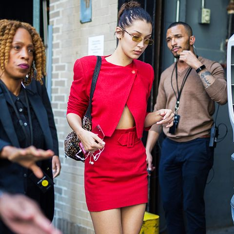 Bella Hadid style: nike trainers and red ensemble