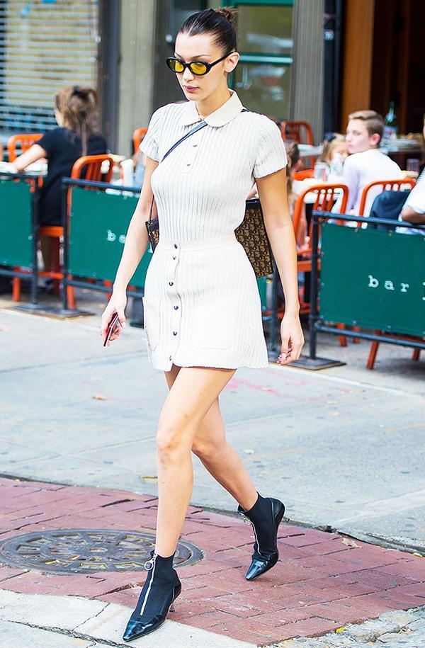 Bella Hadid style: wearing Elizabeth and James glasses and mini dress