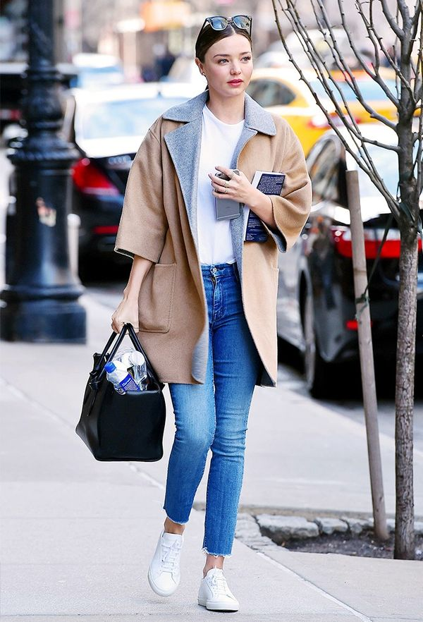 On Miranda Kerr: Max Mara coat; Céline bag; Mother jeans; Kenneth Cole Kam Sneakers ($120).