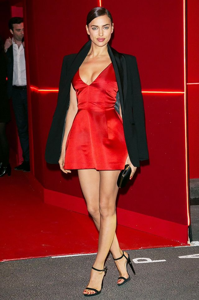 Irina Shayk looked sultry chic at the L'Oréal Red Obsession party in Paris, where she paired her Dior minidress with an oversize black blazer.