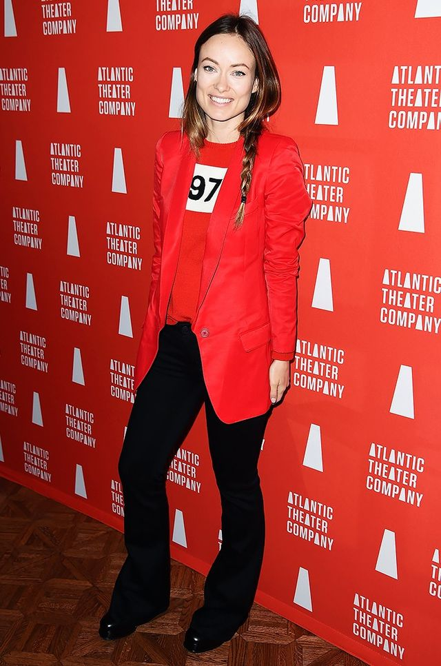 Olivia Wilde opted for casual cool at the Atlantic Theater Company Actors' Choice Gala in black flared trousers, a red Smythe blazer, and Bella Freud's 1970 Wool Sweater (£280).
