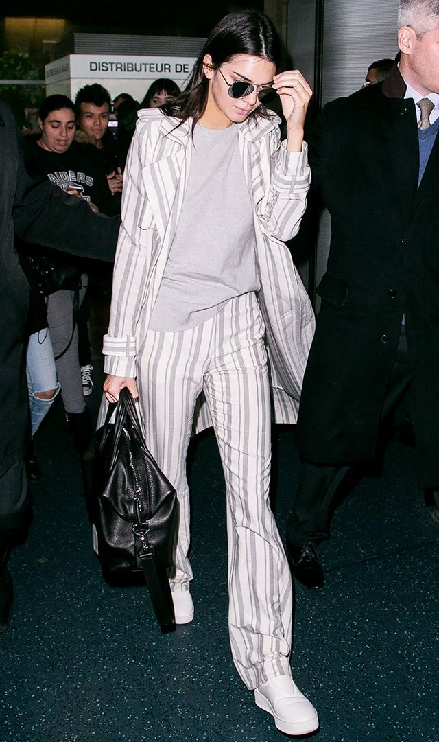 Kendall Jenner exited the airport in a suit set with a pair of aviators to finish off the look.