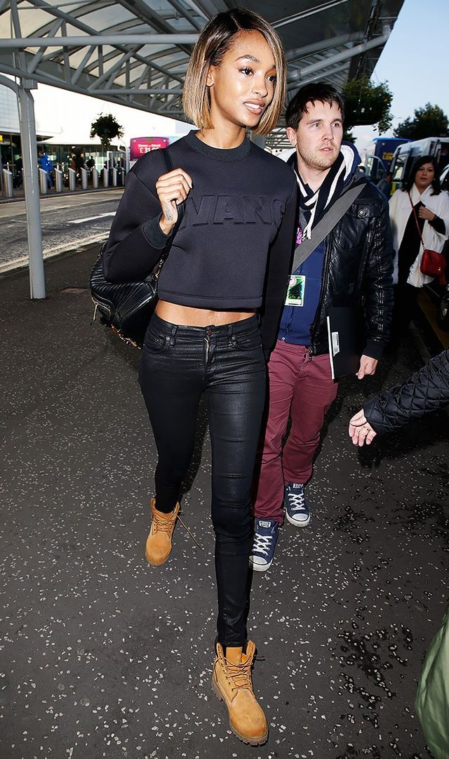 Black skinny jeans got a high-fashion spin thanks to Jourdan Dunn who styled a waxed pair with anAlexander Wang x H&M crop sweatshirt.