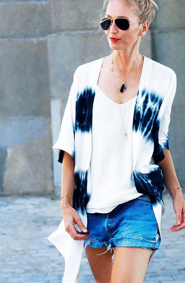 An unfussy kimono works well with summer's cami tops and sawn-off denim shorts.