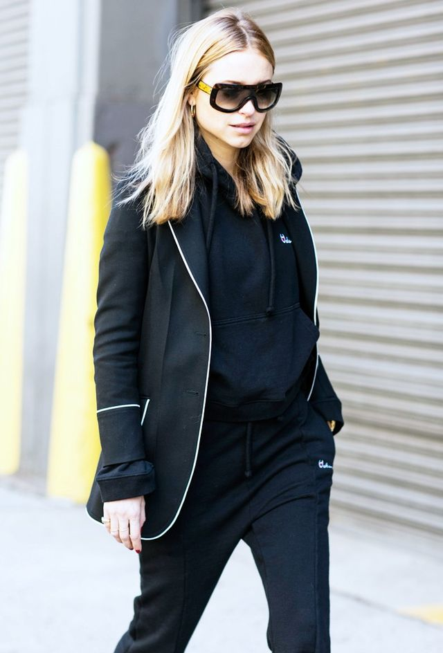 On Pernille Teisbaek: Gucci Silk-Trimmed Wool Blazer (£1200); Vetements Hoodie (£475), and Cotton-Blend Track Pants (£325).