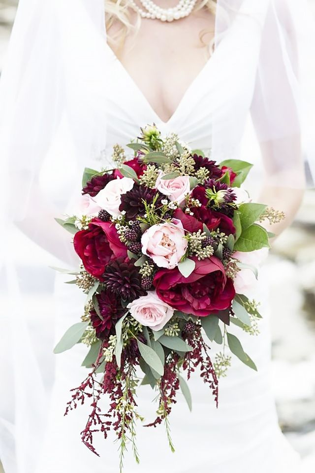 We love everything about this mysterious, alluring bouquet that features pink and deep red peonies, merlot dahlias, and plump blackberries. It's a good idea to have some flexibility when it...