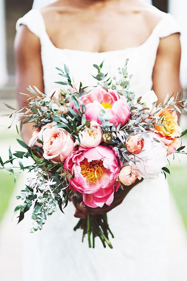 Massive, fully blooming pink peonies and lots of silvery green leaves make up this bouquet that's natural yet elegant. Doesn't it look as if the bride simply gathered them all together...