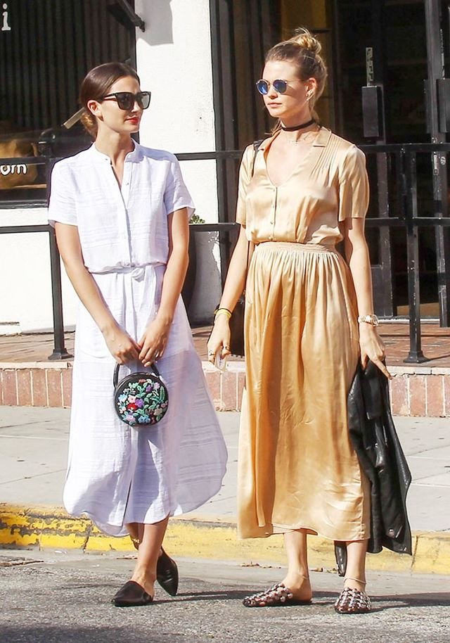 On Lily Aldridge: Reformation Ghana Dress(£153) in Eco Riviera; Jenni Kayne Mule Slides(£281) available in Black Suede. On Behati Prinsloo: Ray-Ban Polarized Round...