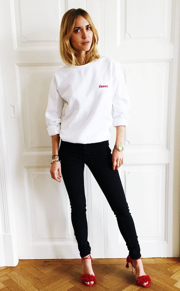 Style Tip: Opt for a girl-next-door ensemble, and wear a simple sweatshirt with your go-to dark denim.