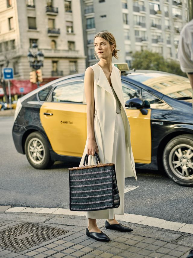 Get the Look: Zara Long Waistcoat (£40), Flowing Culottes (£26), and Striped Tote (£30).