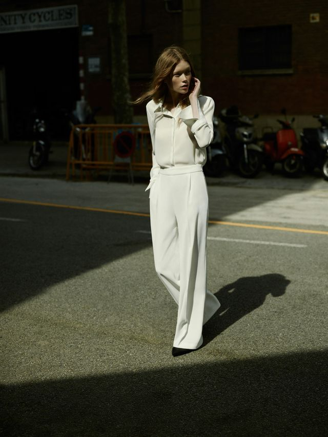 Get the Look: Zara Contrasting Topstitching Shirt (£26), Flowing Palazzo Trousers (£30), and Vinyl d'Orsay Shoes (£30).
